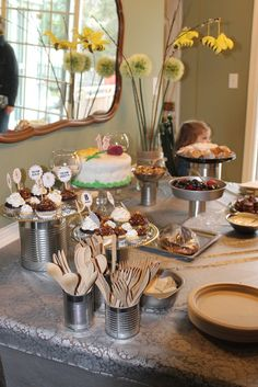 love the tin cans and pie pans to display food and hold utensils