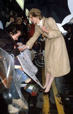 1981-10-28 Visit to Wales - Diana continues to meet crowds in Llandeilo, despite having become soaked from the rain