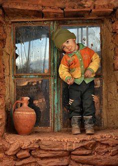 Child In A Window ~ Photo by...Zeki Yavuzak©