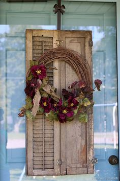 Add character to a wreath by using vintage shutters. The purple flowers on the…
