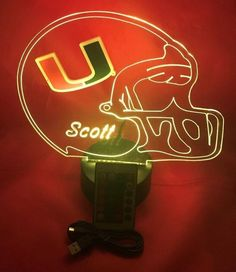 University of Miami Hurricanes Licensed Logo NCAA College Football on Beautiful Handmade Personalized Helmet Light Up Lamp LED With Remote Miami Hurricanes Gear, University Of Miami Hurricanes, Ncaa College Football, Nfl Football Teams, Led Night Light, Night Lights, Helmet Light, Fire Badge, Shape Design