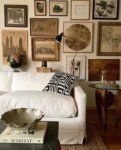 An eclectic interior with a gallery full of vintage art + white slipcover sofa + natural fiber woven rug + coffee table styling + vintage prints Living Room Decor, Living Spaces, Living Rooms, Living Area, Interior Exterior, Interior Design, Lauren Liess, Vintage Modern, Vintage Art