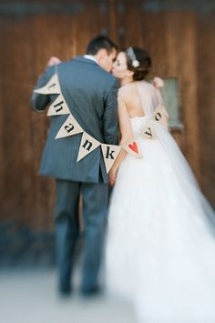 bride and groom with burlap, d-i-y thank-you banner.