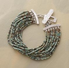"""CASCADE TURQUOISE BRACELET--Myriad strands of tiny turquoise beads wrap your wrist in a ravishing rush. Hand-hammered, high-shine sterling silver toggle. Exclusive. 7-1/2""""L."""