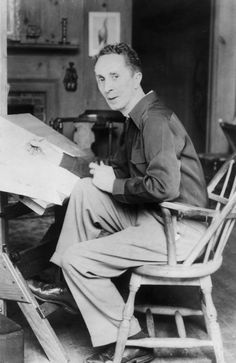 Norman Rockwell. Drawing with one hand, and smoking his pipe with the other.