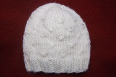 Ravelry: Wrapped Stitches Baby Hat pattern by Heather Tucker