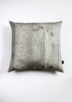 "concrete cushion cover, which is part of the ""Making Hard Things Soft"" collection. $98 by Kollekt"