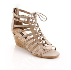 $79.98 Kelin - Take charge in gladiator sandals. Braided straps and flirty cutouts channel runway trends with exotic flair.This taupe pair is perfect for easy, everyday wear. Complete with a lace up closure, this shoe ties at the ankle for a flawless fit.