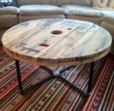 DIY IDEA >>> Round reclaimed / salvaged wood spool table with steel pipe base. Great rustic / industrial style piece - Keith can make? Pipe Furniture, Furniture Projects, Furniture Design, Furniture Decor, Building Furniture, Furniture Removal, Furniture Stores, Office Furniture, Cheap Furniture