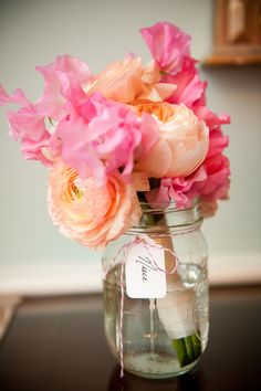 Keep your bridesmaids bouquets fresh and use them as table decor at the same time