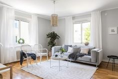 Livingroom grey sofa scandinavian interior. Styling by Studio In AB