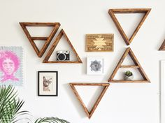 Perfect for displaying succulents and trinkets, these geometric reclaimed wood triangles look great hanging on the wall or sat on a shelf. This listing is for a Set of 3 shelves: 2 x triangle / 1 x triangle with shelf. Choice of sizes: 25cm / 10 30cm / 12 35cm / 14 40cm / 16 Depth approximately 7.5cm / 3 Includes hanging nails. (Use 1 nail per shelf if hung upright, 2 nails if hung upside down!) The wood is carefully sanded multiple times to achieve a smooth touch whilst retaining its age...