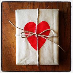 Kraft paper with variety of red painted items -- ornament, berries, pinecone, etc.