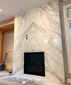 Bookmatched fireplace supplied by Marble Trend featuring Neolith Calacatta polished. Granite Fireplace, Home Fireplace, Marble Fireplaces, Fireplace Remodel, Modern Fireplace, Living Room With Fireplace, Fireplace Design, Fireplace Mantels, Fireplace Tiles
