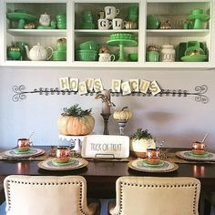 Our idea of the perfect fall table decor. Easy transition from Halloween into Thanksgiving with some switching of platters and plates. Also, loving succulent pumpkins!