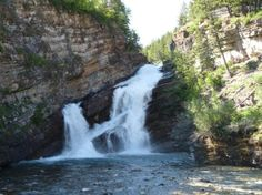 Cameron Falls in Waterton National Park in Alberta Canada. Waterton was always a favorite place to visit, hike and picnic on a summer day or at family reunion time. Two places were must stops when in Waterton - Cameron Falls and the lake for skipping rocks if it was calm with little wind.