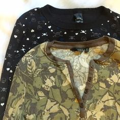 Two Hurley Thermal Shirts Selling both of these Hurley Thermals together. One is black with skull and heart print and the other is a button down neck with a camo color leaf print. These are great for staying warm snowboarding or just wearing casually! Both size medium Hurley Tops Tees - Long Sleeve