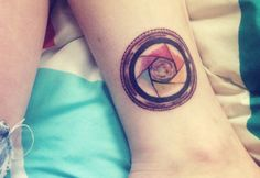 Camera lens with a color wheel as its aperture #tattoo #ink