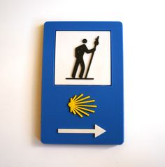 (http://www.spanishdoor.com/camino-de-santiago-scallop-shell-and-arrow-road-sign-marker-pilgrim-souvenir-fridge-magnet/) #CaminoDeSantiagoRoadMarker