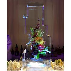 floral ice sculpture - frozen flowers for the new museum's 40th anniversary gala dinner. by tin can studios.