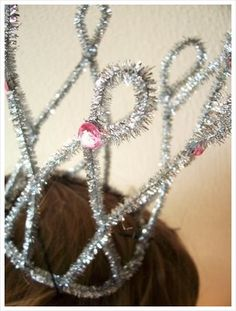 Made these crowns and paper hats for New Year's party. Decorated my tree with these and other noise makers. Super easy.