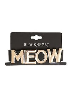 "Black faux leather bracelet with movable silver tone metal letters that spell ""Meow."" Adjustable silver tone snap-button closure.Man-made materials7"" longImported"