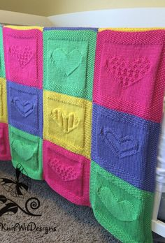 Knitting Pattern for Lots of Heart Baby Blanket - Easy blanket made of 4 different heart designs in knit and purl stitches