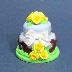 Dolls house miniature cake Easter bunny cake in blue and yellow dollhouse food. $14.00, via Etsy.