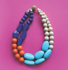 Color block time! Resin beads in beautiful colors in cobalt blue, tangerine orange, cream & sky Tiffany Blue. 20 inches long.