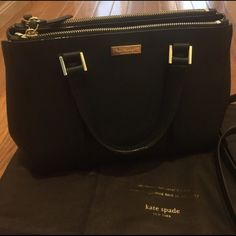 "Kate Spade Black Leather Handbag/ Tote Authentic Kate Spade Tote✨ -Comes w dust bag and care card -Detachable side purse strap ⚠️Very small scuffs on the bottom gold studs that show sign of wear (Not noticeable 2nd pic) Handbag measurements & details: -Saffiano leather: 14 karat light gold hardware, 11""W x 8""H x 4.5""D -Top handles with 5"" drop 