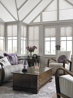 Add a touch of colour to your conservatory with scattered accessories and cushions...
