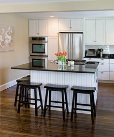 white kitchen islands | White and Black Kitchen with Large Island image via CliqStudios
