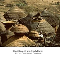 Africa | Kirdi huts and granaries; thatched with millet stalks, which protect the stone and loam buildings from sun, rain and insects. Mandara Mountains, northern Cameroon. | ©Carol Beckwith and Angela Fisher