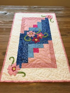 A personal favorite from my Etsy shop https://www.etsy.com/listing/513760419/pink-and-blue-table-runner-with-floral