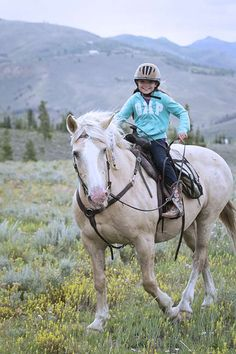 No matter what the kids try, we make sure everyone stays safe on our family vacation horseback trips - helmet included!