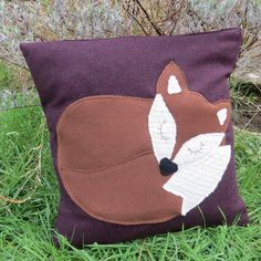 A snoozy fox on aubergine wool.  Fox cushion.  by TheSherbetPatch