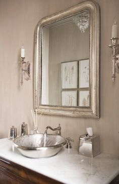 Ikea has a version of this mirror. I think it's called Stonge