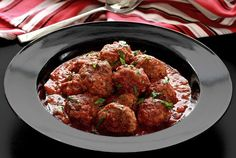 Simple crock pot recipe for paleo meatballs with hearty Italian seasonings in a rich marinara sauce. Packed with flavor and completely gluten free and paleo.