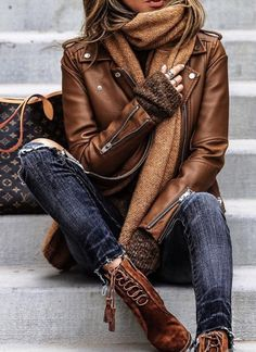22515807980 Cute brown leather jacket and boots with trendy distressed denim jeans.