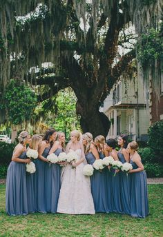 Bridal party beneath Spanish moss, cornflower blue bridesmaid dresses // Hyer Images