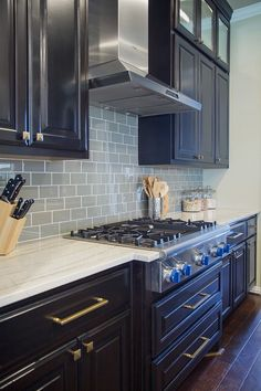 Do this |  Designer: Carla Aston, Photographer: Tori Aston, quartzite countertops, glass tile backsplash