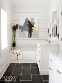 Builders Floor Covering & Tile installed the sleek Black Blizzard slate flooring in the otherwise neutral master bathroom.