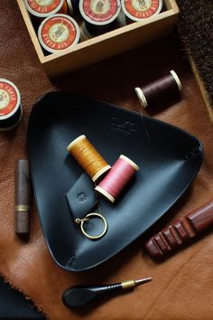 Items similar to Handmade leather valet tray, triangle leather tray to Decorate your home & office, organized your desk and your accessories. on Etsy Leather Valet Tray, Leather Box, Leather Gifts, Tan Leather, Handmade Leather, Leather Keychain, Vegetable Tanned Leather, Leather Accessories, Natural Leather