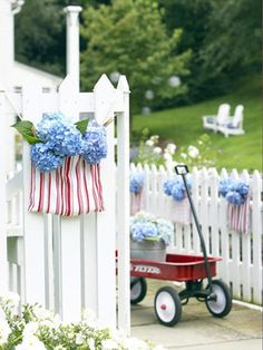 Stars in Stripes      Show off your red and white (dishtowel) and blue (hydrangeas). Fold a towel in half over a gallon-size zip-seal bag and cut the towel 1/8 inch larger than the bag. Staple the towel together along the sides; hang with clothespins; add water and flowers.