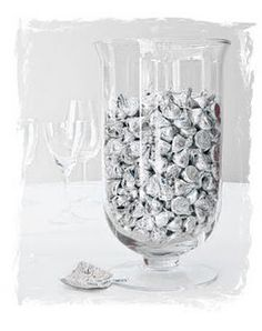 Vases filled with silver wrapped kisses or other candy.