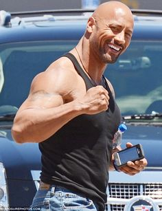 Not so armless: The Rock was revelling in showing off the results of his workout regime as he prepared for the film
