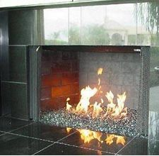HM FIREPLACE GLASS CLEANER    Pre-treat fireplace glass by rubbing plain baking soda over its surface. Acts as both an abrasive and a cleaner to remove any soot or grime. Wipe away.    Fill spray bottle three-fourths full with warm water. Add 1/4 tsp of baking soda, 1/2 tsp vinegar, & 1/2 tsp lemon juice or ammonia. Cover & shake well until baking soda is dissolved.