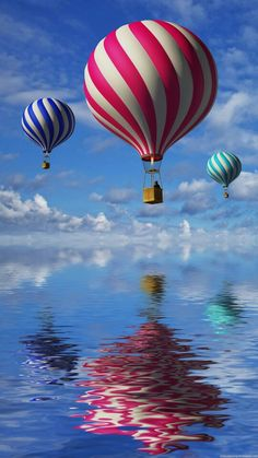 Hot air balloons over water ♡