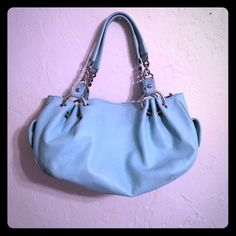 """Spring Color Juicy Couture Purse Baby Blue Juicy purse. Bought this on Poshmark last week, but it wasn't the size that I thought it was. Body of the purse is 14"""" x 8"""" straps are about 8"""" Excellent condition. Previous owner says she bought it at Nordstrom for $110. Offers welcome. Juicy Couture Bags Shoulder Bags"""