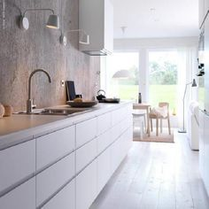 IKEA NODSTA A white kitchen with aligned doors, a white floor and a grey concrete wall Ikea New Kitchen, Ikea Metod Kitchen, Ikea Kitchen Design, Narrow Kitchen, Kitchen Living, Kitchen Interior, Kitchen Decor, Handleless Kitchen, Kitchen Layouts